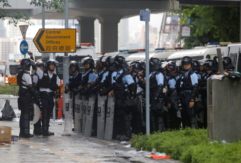 Riot police gather outside the Legislative Council, following a day of violence in Hong Kong