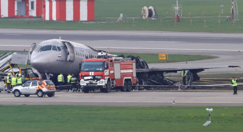 FILE PHOTO: Members of emergency services work at the scene of an incident involving an Aeroflot Sukhoi Superjet 100 passenger plane at Moscow's Sheremetyevo airport