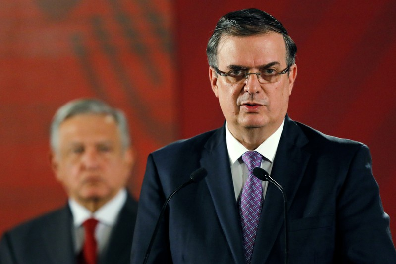 Mexican Foreign Minister Marcelo Ebrard speaks during a news conference as Mexican president Andres Manuel Lopez Obrador looks on, at National Palace in Mexico City