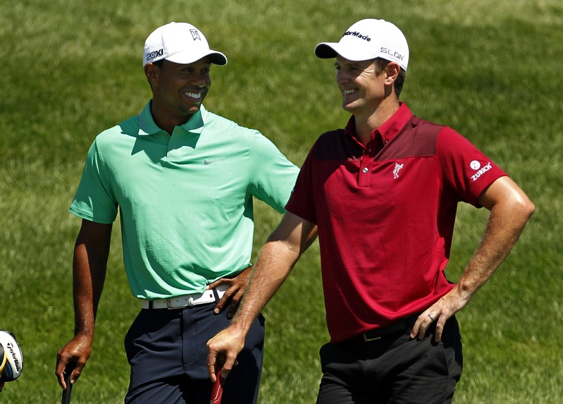 Woods of the U.S. jokes with Rose of England during the third round of the Barclays PGA golf tournament in Jersey City