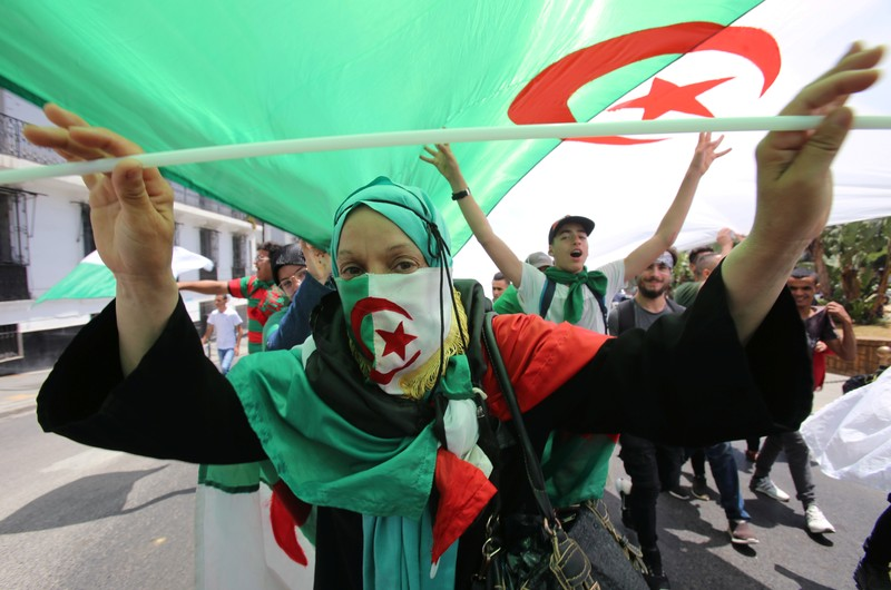 A demonstrator gestures during a protest demanding the removal of the ruling elite in Algiers
