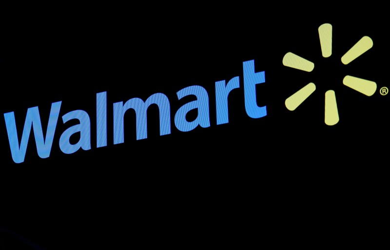 FILE PHOTO: The Walmart logo is displayed on a screen on the floor of the NYSE in New York