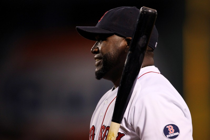 FILE PHOTO: Boston Red Sox's Ortiz smiles during warmups before facing the Toronto Blue Jays in their MLB American League East baseball game in Boston
