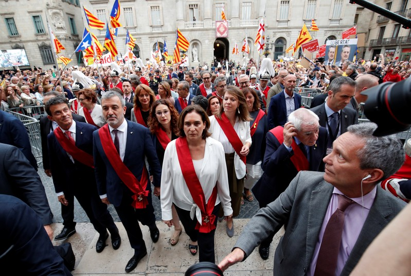 Barcelona's new Mayor Ada Colau walks next to Jaume Collboni, Ernest Maragall and Manuel Valls after her swearing-in ceremony, at Sant Jaume square in Barcelona