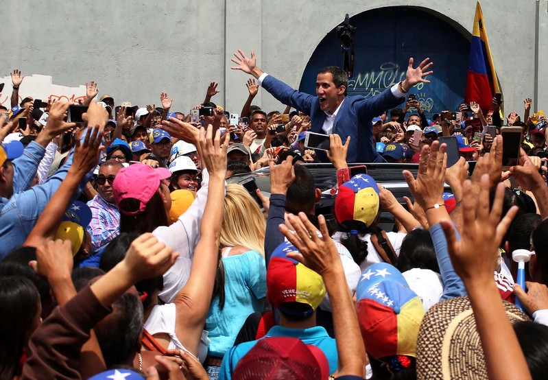 Venezuelan opposition leader Juan Guaido, who many nations have recognised as the country's rightful interim ruler, greets supporters after delivering a speech, in Merida