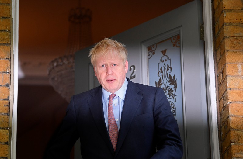 Johnson, leadership candidate for Britain's Conservative Prime Minister, leaves home in London