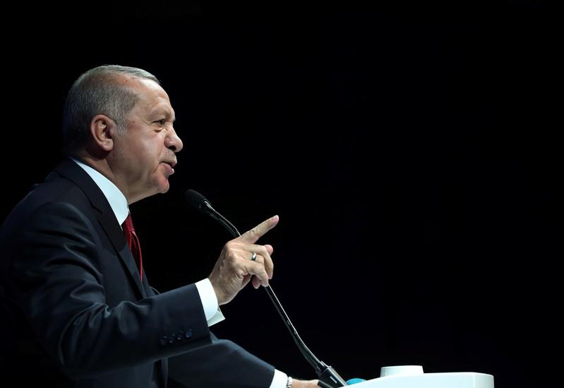 FILE PHOTO: Turkish President Erdogan addresses bussiness people during a meeting in Ankara