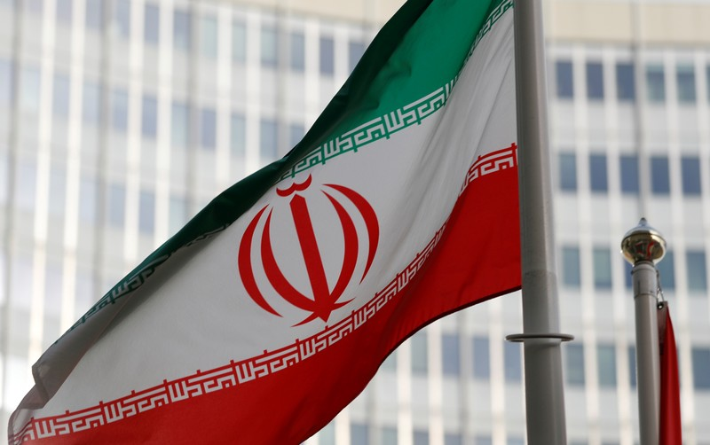FILE PHOTO: The Iranian flag flutters in front the International Atomic Energy Agency (IAEA) headquarters in Vienna