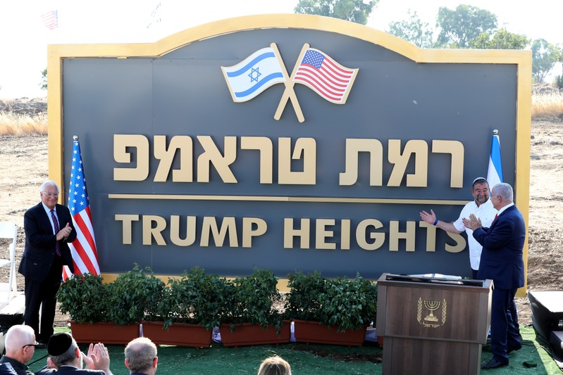 Israeli Prime Minister Benjamin Netanyahu and U.S. Ambassador to Israel David Friedman attend a ceremony to unveil a sign for a new community named after U.S. President Donald Trump, in the Israeli-occupied Golan Heights