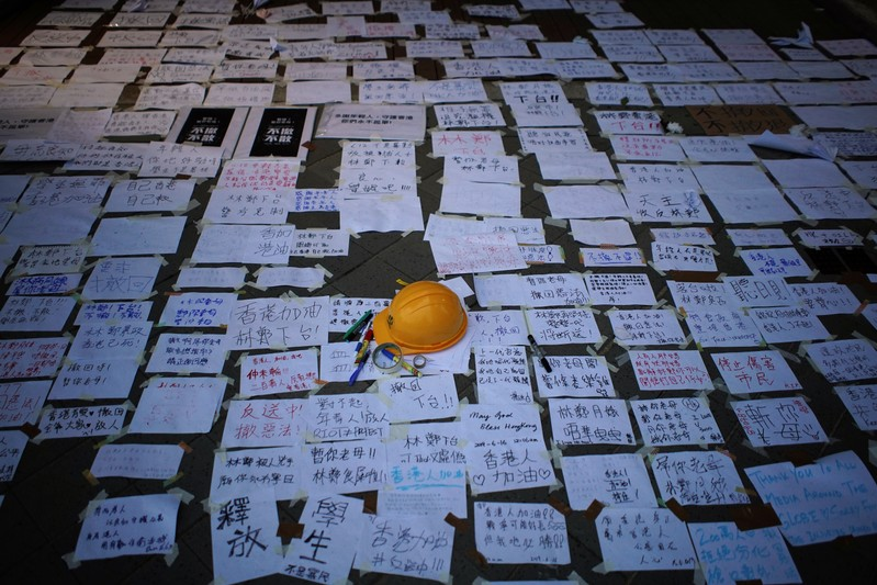 A helmet and messages of support for the protest against a proposed extradition bill, are seen displayed early morning in Hong Kong, China