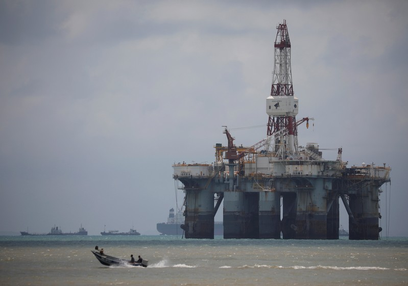 FILE PHOTO: An oil rig is seen in the waters on the southern coast of Pengerang