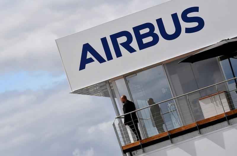 FILE PHOTO: A man stands at an Airbus trade pavilion at Farnborough International Airshow in Farnborough, Britain
