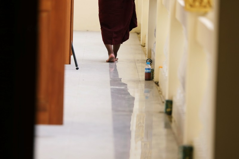 Buddhist monk leaves the annual meeting of the nationalist group Buddha Dhamma Parahita Foundation, previously known as Ma Ba Tha in Yangon,