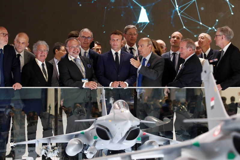 French President Emmanuel Macron, listens to Eric Trappier, Chairman and CEO of Dassault Aviation, during a visit at the 53rd International Paris Air Show at Le Bourget Airport