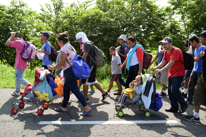 Migrants from Central America walk on a highway during their journey towards the United States, in Ciudad Hidalgo
