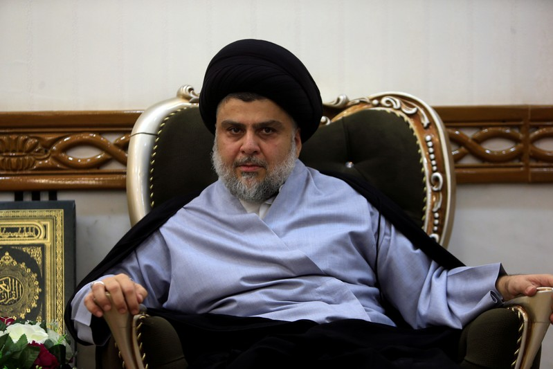 Iraqi Shi'ite cleric Moqtada al-Sadr, who's bloc came first, meets with Iraqi Prime Minister Haider al-Abadi, who's political bloc came third in a May parliamentary election, in Najaf