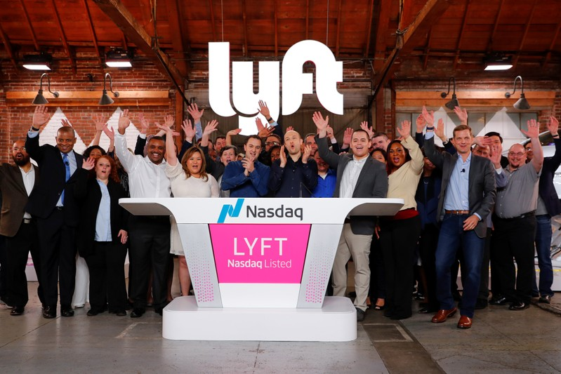 FILE PHOTO: Lyft President John Zimmer and CEO Logan Green applaud as Lyft lists on the Nasdaq at an IPO event in Los Angeles