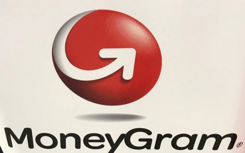FILE PHOTO: The MoneyGram logo is seen on a kiosk in New York