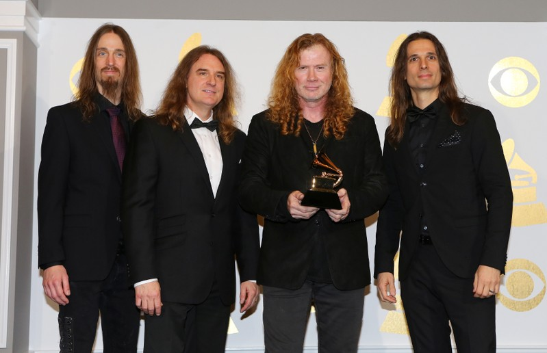 FILE PHOTO: Members of Megadeth hold the award for Best Metal Performance for