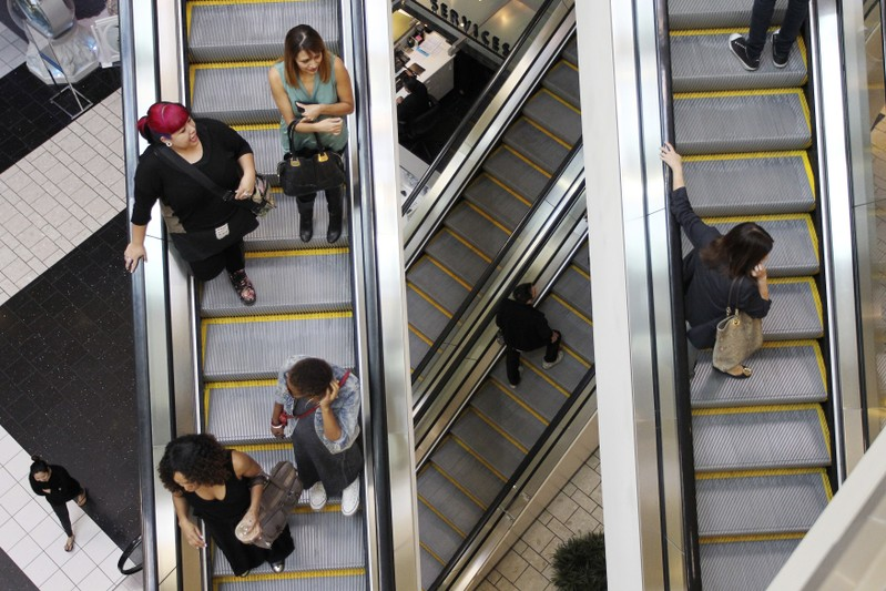 Shoppers ride escalators at the Beverly Center mall in Los Angeles