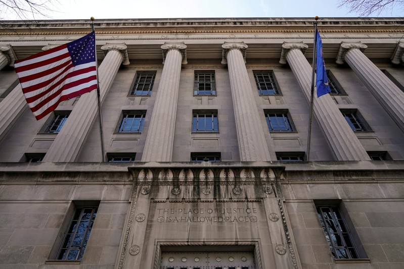 FILE PHOTO: A flag flies from the Department of Justice in Washington