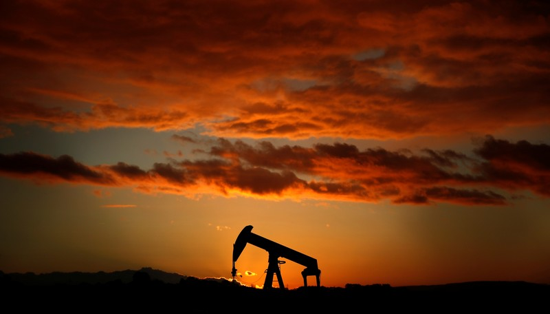 FILE PHOTO: A pumpjack is seen at sunset outside Scheibenhard, near Strasbourg