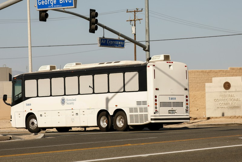 Immigration and Customs Enforcement (ICE) detainees arrive at FCI Victorville federal prison in Victorville