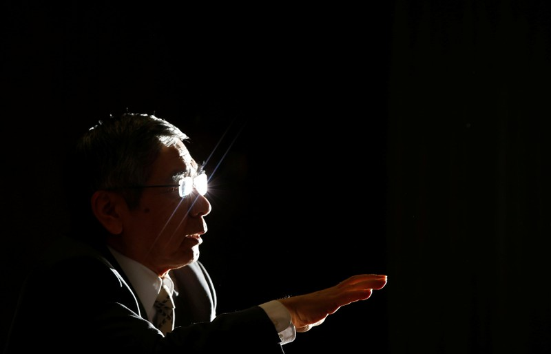 FILE PHOTO: Bank of Japan Governor Kuroda speaks during a group interview at the BOJ headquarters in Tokyo