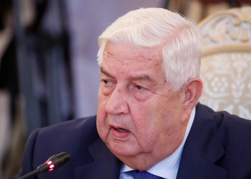 FILE PHOTO: Syrian Foreign Minister al-Moualem speaks during a meeting with Russian Foreign Minister Lavrov in Moscow