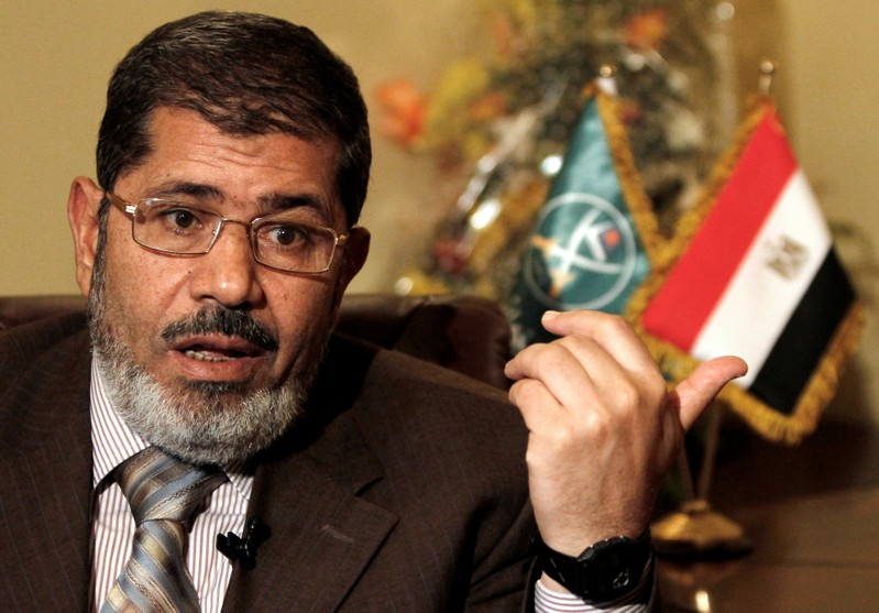 FILE PHOTO - Mohamed Mursi, head of the Brotherhood's newly formed Justice and Freedom Party gestures during an interview with Reuters in Cairo