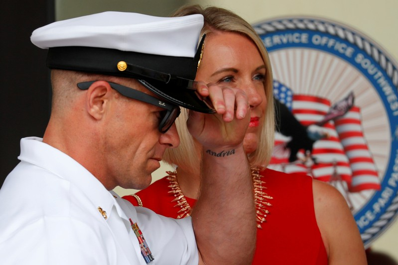 U.S. Navy SEAL Special Operations Chief Gallagher leaves court with his wife after the first day of jury selection at the court-martial trial at Naval Base San Diego