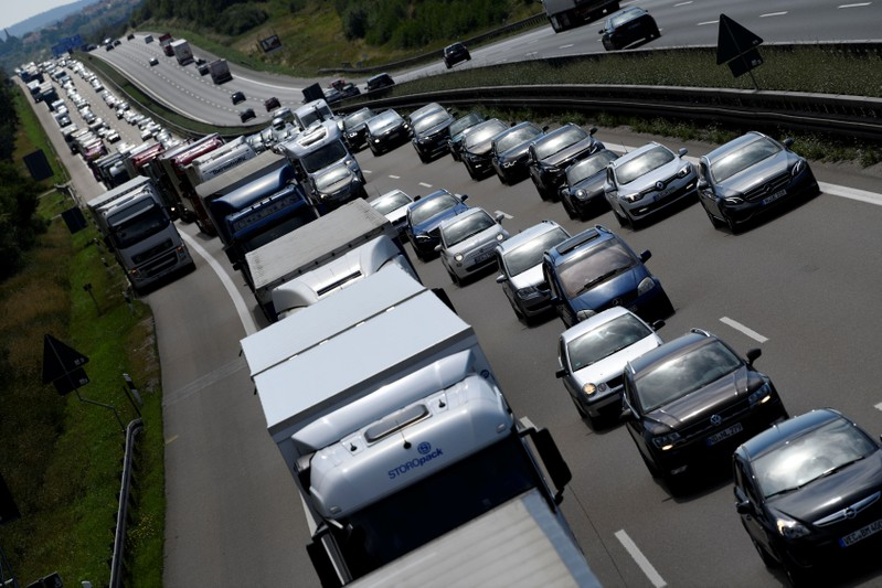 Cars and trucks drive along a motorway near Roth