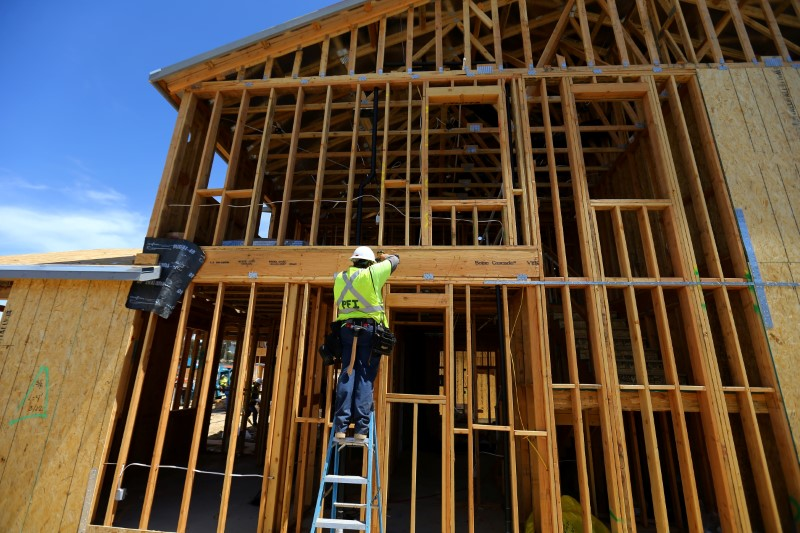 FILE PHOTO: Single family homes being built by KB Homes are shown under construction in San Diego