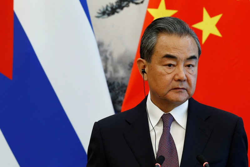 FILE PHOTO: Chinese Foreign Minister Wang Yi attends a news conference at Diaoyutai state guesthouse in Beijing