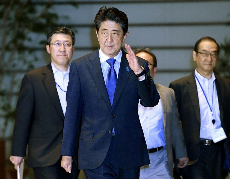 Japan's Prime Minister Shinzo Abe arrives at his official residence after an earthquake, in Tokyo