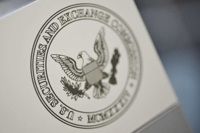 FILE PHOTO: The U.S. Securities and Exchange Commission logo adorns an office door at the SEC headquarters in Washington