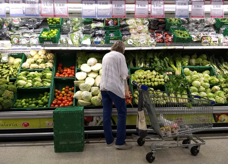 A woman shops in a supermarket in Buenos Aires