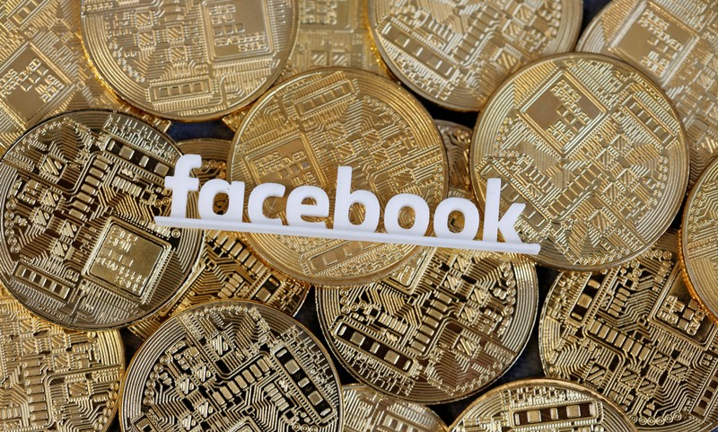 Facebook logo is seen on representations of virtual currency in this illustration picture