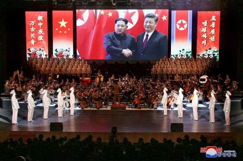 An image of North Korean leader Kim Jong Un and China's President Xi Jinping is displayed during a North Korean delegation's visit in Beijing