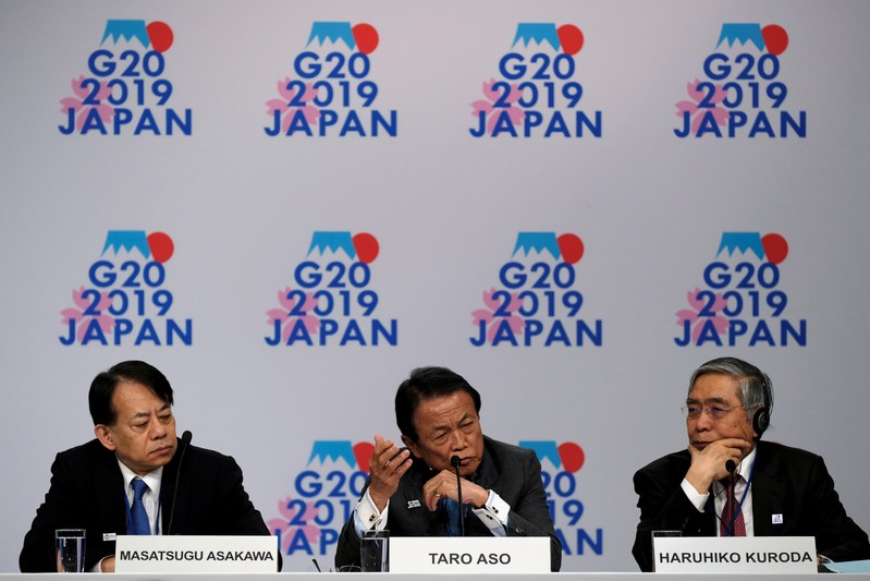 FILE PHOTO: Japanese Vice Minster of Finance Asakawa, Finance Minister Aso, and Bank of Japan Governor Kuroda hold a news conference at the IMF and World Bank's 2019 Annual Spring Meetings, in Washington