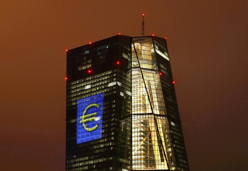 FILE PHOTO: Headquarters of the European Central Bank (ECB) are illuminated with a giant euro sign in Frankfurt