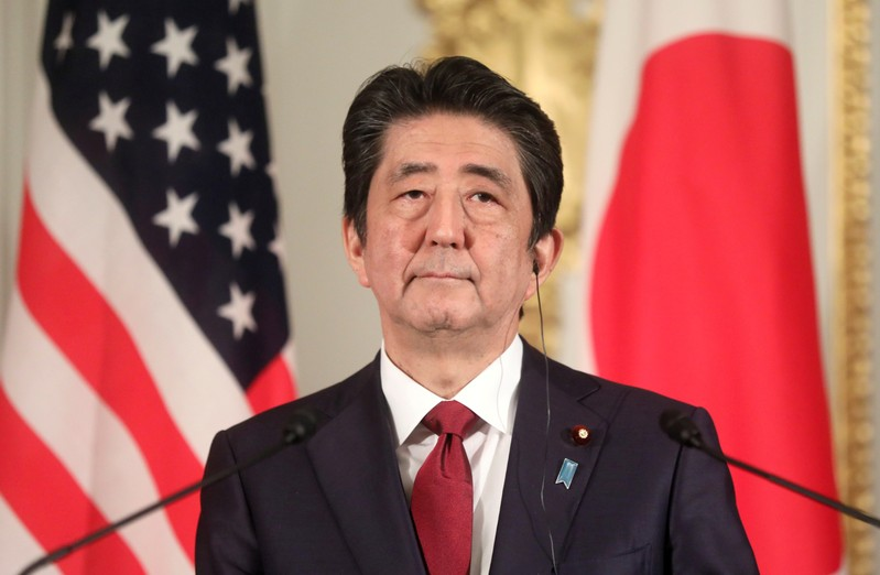 FILE PHOTO: Japanese Prime Minister Shinzo Abe holds a joint news conference with visiting U.S. President Donald Trump (not pictured) in Tokyo