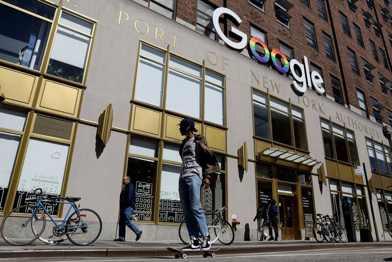 FILE PHOTO: People pass by an entrance to Google offices in New York