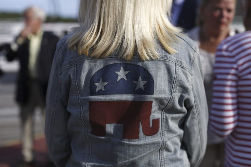 FILE PHOTO - A Republican supporter wears a party logo on her denim jacket before a sunset cruise with the Belknap County Republicans in Laconia