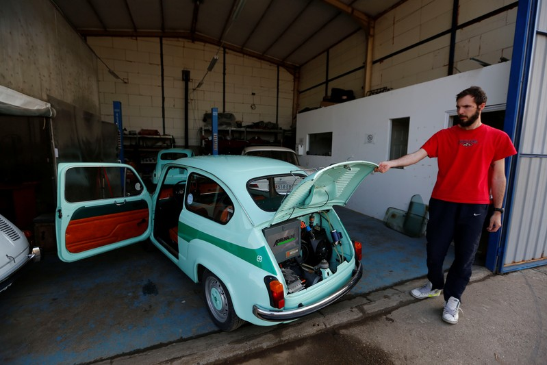 A worker opens the hatch of converted supermini car Zastava 750, which has its combustion engine replaced with an electric one by BB Classic Cars, in Skopje