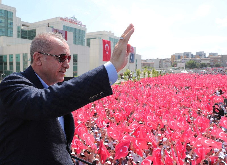Turkish President Erdogan greets his supporters during an opening ceremony in Istanbul