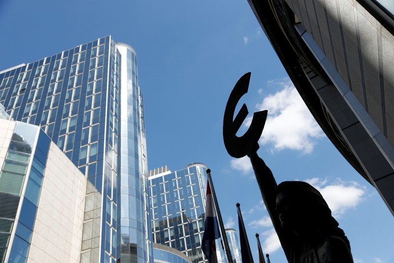 FILE PHOTO: A sculpture with Euro symbol is pictured in front of the European Parliament in Brussels