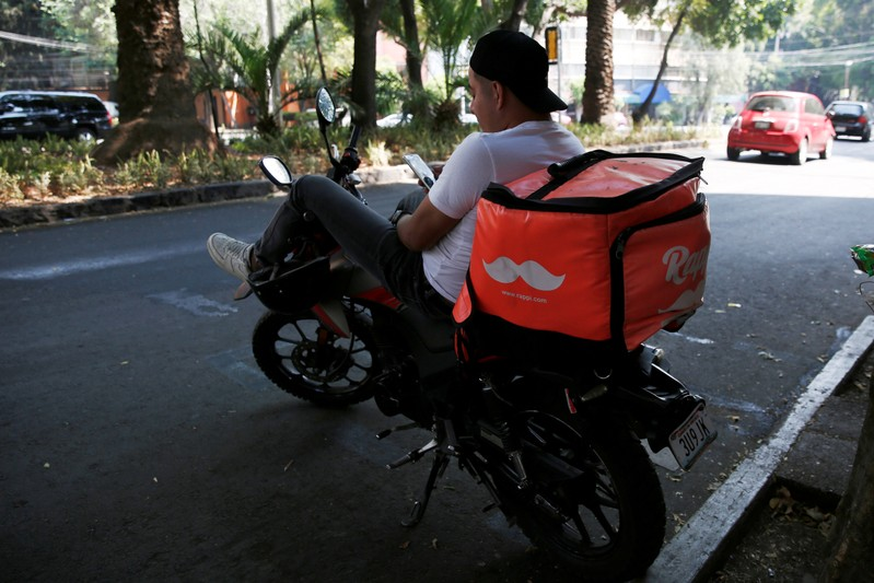 The logo of Colombian on-demand delivery company Rappi is seen on a delivery bag in Mexico City