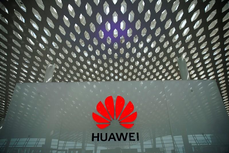 FILE PHOTO: A Huawei company logo is seen at the Shenzhen International Airport in Shenzhen in Shenzhen