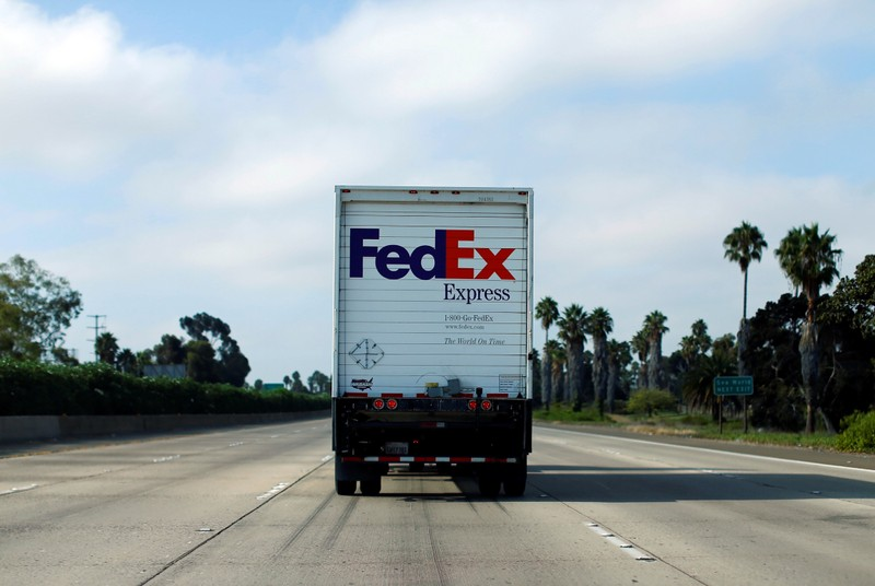 FILE PHOTO: Federal Express truck makes way down a highway in San Diego, California